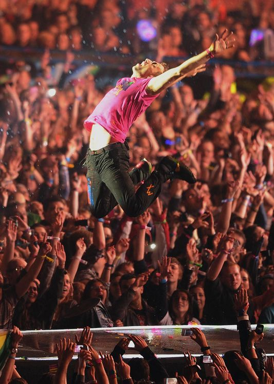 If you've never been to a Coldplay concert, you are missing out! One of my favorite photo of Chris on stage :)