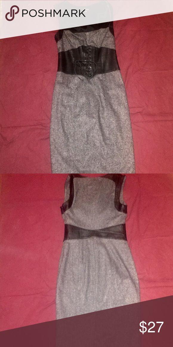 Rockabilly bombshell pin up corset dress. Cute corset belt built into the dress. Cute for a pinup rockabilly look or everyday office attire. bebe Dresses