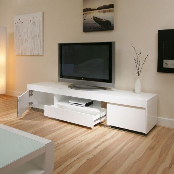 LARGE TV Television Cabinet Entertainment Unit Center White gloss The Stunning 912F TV Stand / Cabinet 2.2 mtrs long, Has Plenty Of Storage Space and An Open Media Shelf with Cable Management And Is Suitable For Any Size Television. Features include beautiful design, 2 doors and 2 central shelves for AV equipment. ▲ Show less Assembly and removal of packaging service available at an extra charge - please call for quote. Matching Sideboard and coffee tables also available.
