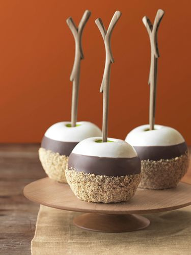 S'mores meets candied apples in these triple dipped s'mores apples. Pair the chocolate with Granny Smith apples for a sweet and tart combination everyone will enjoy at a Halloween event.