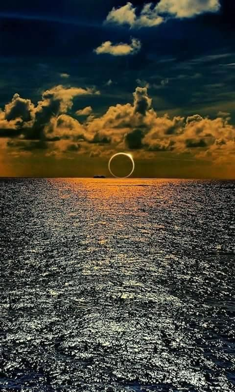 Sunset eclipse on the ocean.