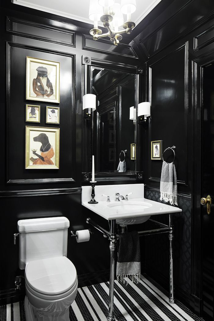 Black paneled bathroom walls.