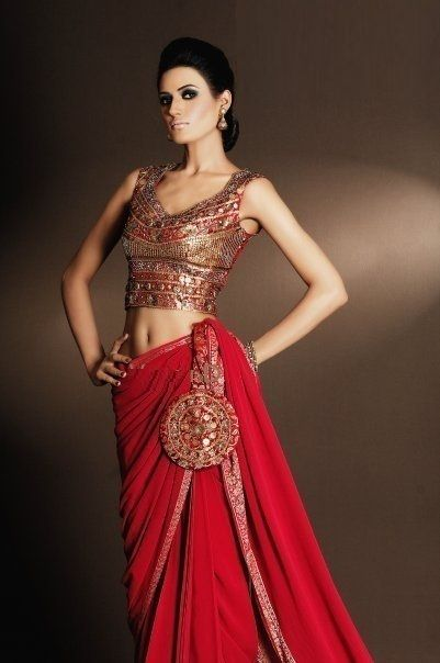 Classic Red Sari – We love the heavily embellished blouse with the plain red sari. #SouthAsianCouture