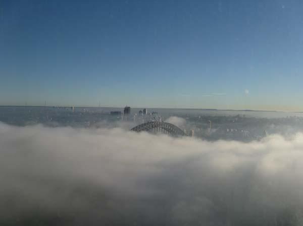 The blanket of fog over the Harbour Bridge.