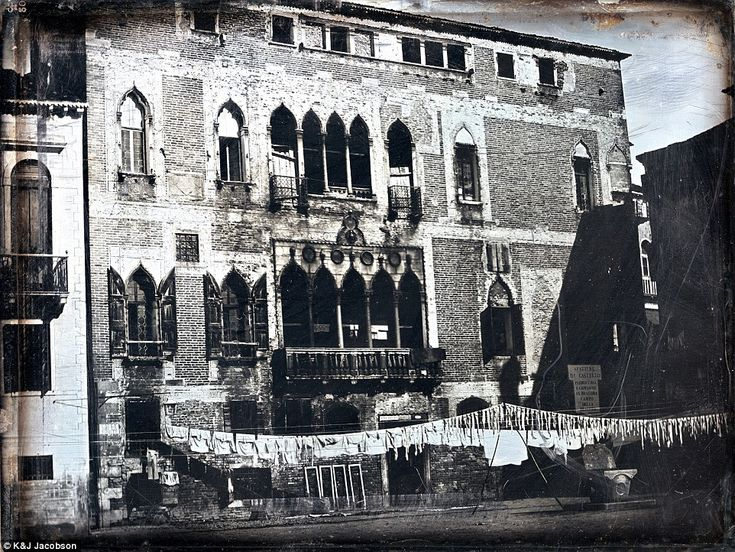 This photo shows Palazzo Gritti-Badoer with laundry hang drying on lines outside (circa 18...