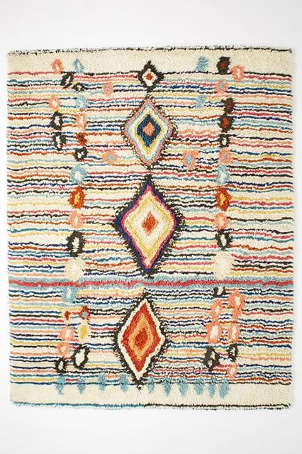 Your Home Just Got WAY Cozier #refinery29  http://www.refinery29.com/best-rugs#slide-3  This Moroccan style rug adds a ton of texture to your place, and the bright colors put a unique spin on the classic design. West Elm Charm Wool Rug, $1,329, available at West Elm....