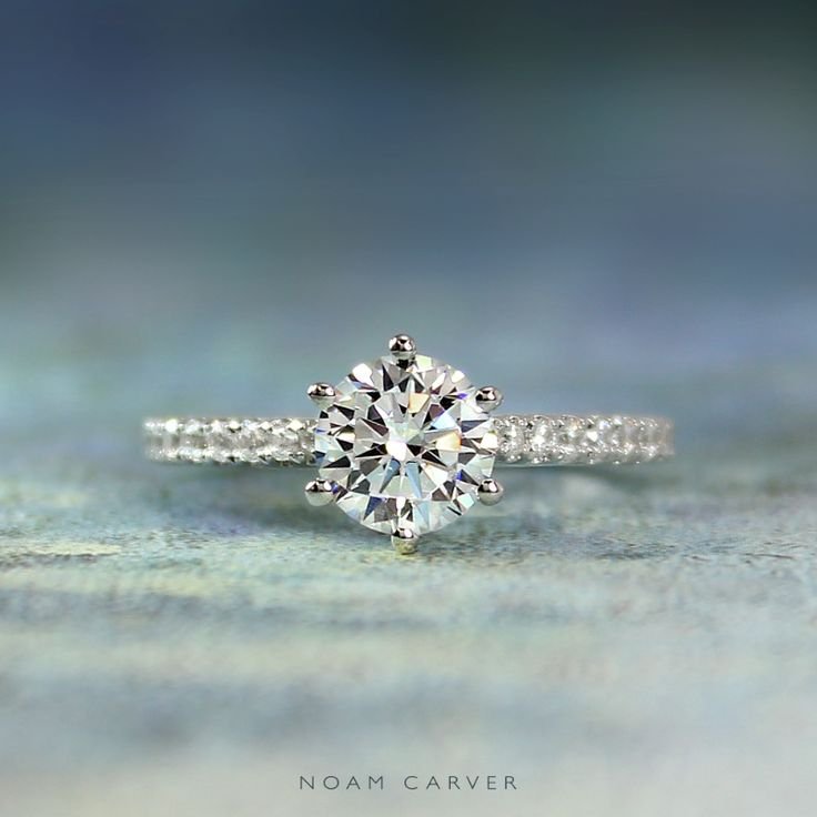 Love is… To drown in her eyes every day.  A six-prong classic engagement ring by Noam Carver. See more here: http://noamcarver.com/details.asp?SKU=B145-17YM-100A