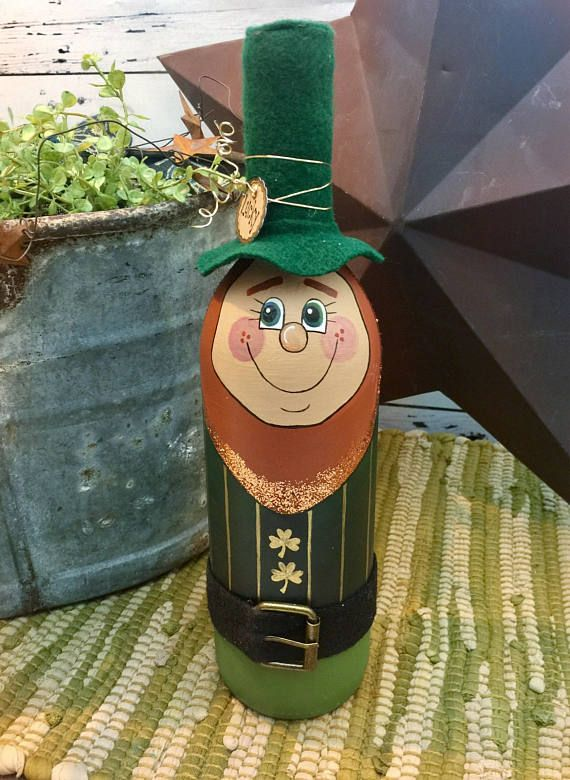 This St. Patricks Day, show off your heritage, (or just your spirit!) by displaying this insanely cute leprechaun bottle! This guy is easy to prop on a shelf or counter top and makes a great gift! Leprechaun Wine Bottle Decor • Great housewarming, birthday, holiday, or hostess gift •