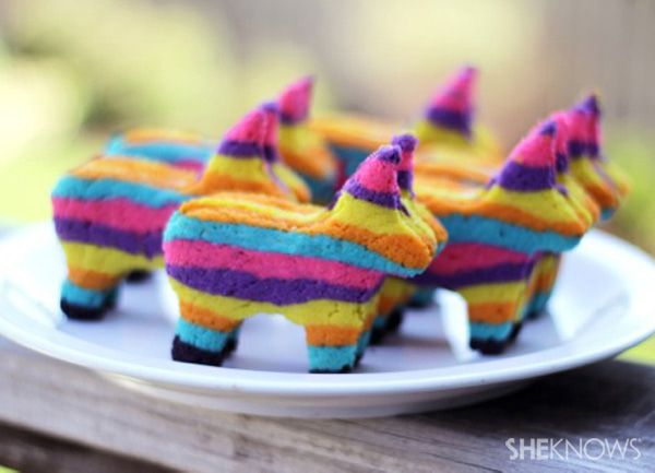 SheKnows.com: Cinco de Mayo Piñata Cookies ~ These multi-striped, burro piñata sugar cookies come complete with hollow centers that you can fill with a secret stash of your favorite candies. Break open or bite into these festive treats and be greeted with a sugary surprise. Olé!