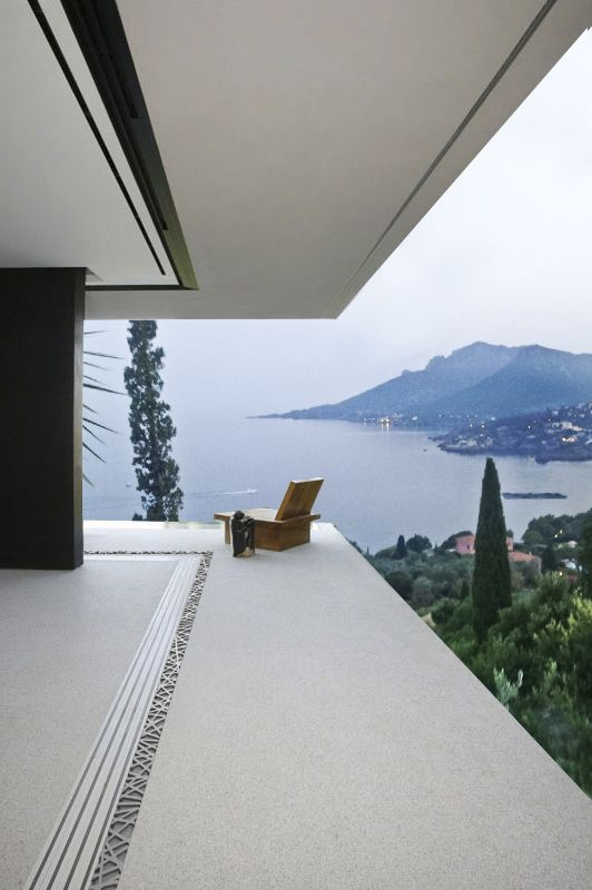 Stunning view from the balcony of a modern villa in france, using the aquabocci R-47 zero threshold drain with Ribbon style drain lid.