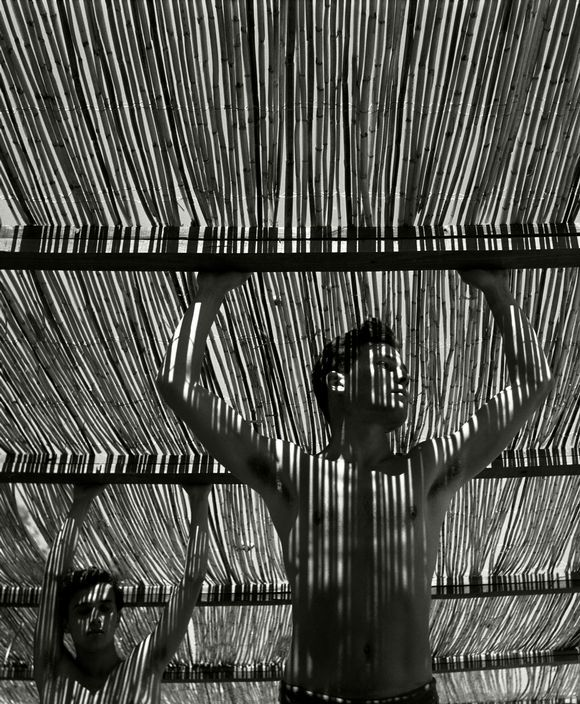 "Herbert List. SPAIN. Andalucia. Torremolinos. 1951. ""Young men under reed roof""."