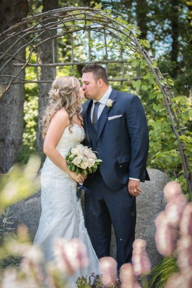 Sarah and Cole's wedding color pallet was soft grey and navy. The bridesmaid dresses were a bold navy color and had some lace detailing at the top. Then the groomsmen wore nice soft grey suits with a navy tie to match the bridesmaid dresses. The colors tied in perfectly together.