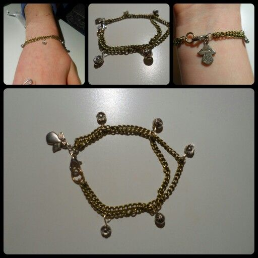 Bracelet made with lengths of chain and charms. Love the little angle on it too. Very cute