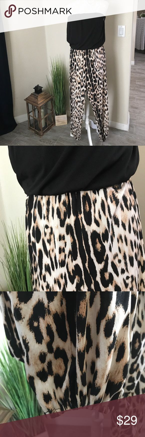 """Sexy & Alluring Animal Print Strapless Jumpsuit This NWOT Jumpsuit is SEXY! Alluring animal print, elasticized ankle pants with a black bandeau, fully lined, flounced top make this a summertime hit - pair it with some strappy stiletto sandals and you'll be ready to prowl the night. It is new, never worn! 31"""" inseam. From a smoke free home. 🍷 VENUS Pants Jumpsuits & Rompers"""
