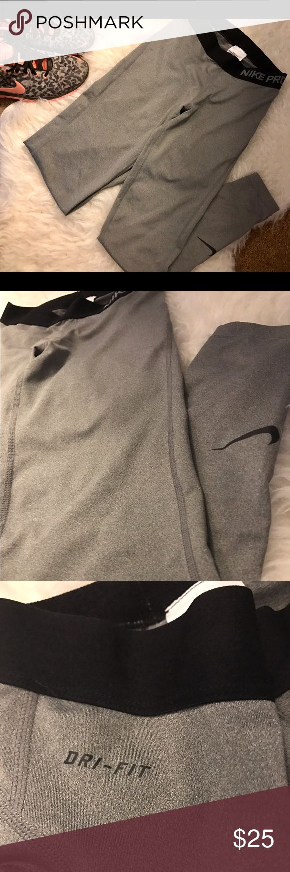 Nike Pro Dri-Fit Tights Great condition, grey with black Nike logo on left leg. Full length. 80% polyester, 20% Spandex. Nike Pants Leggings