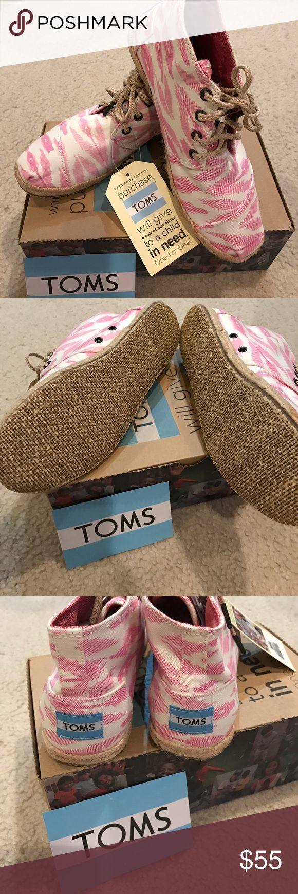 Brand new TOMS pink and white Brand new TOMS in pink and white. Size 7., will fit up to 7.5. Jute rope detail and laces. Super cute and chic. Includes original box and sticker. No Trades or holds. TOMS Shoes