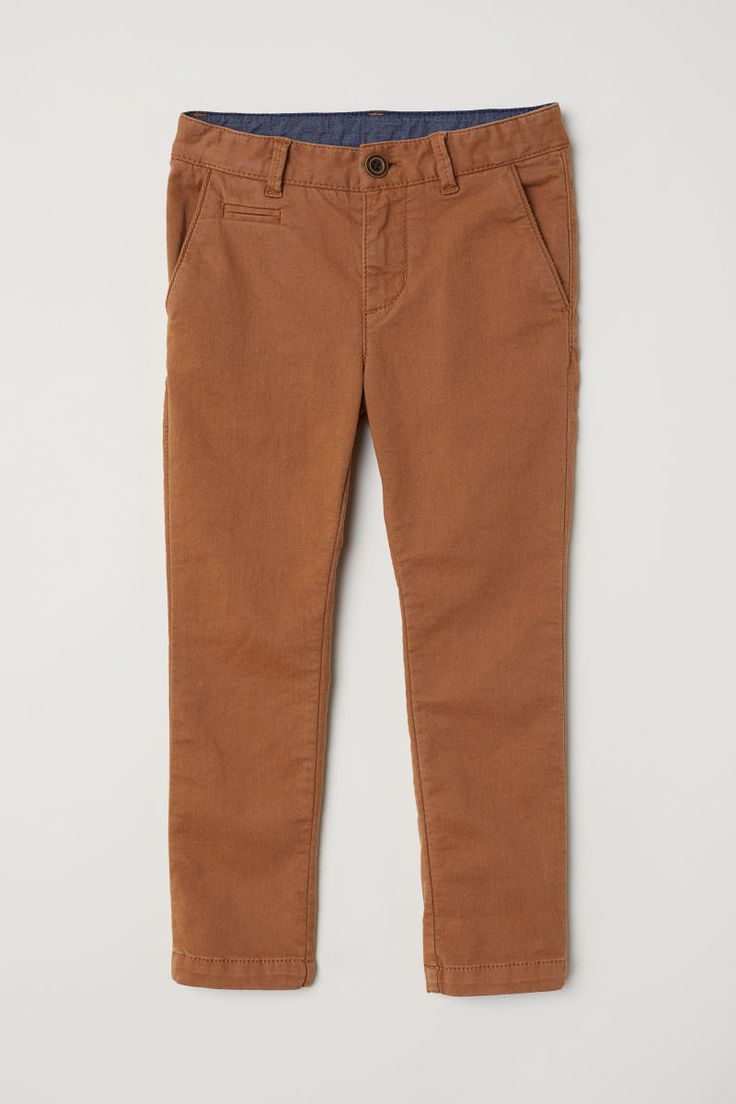 Light brown. Chinos in washed stretch cotton twill with an adjustable elasticized waistband and zip fly with button. Side pockets and welt back pockets.