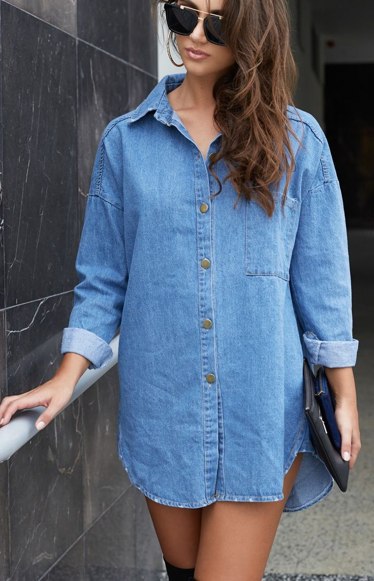 Ever been a sightseer in your own hometown? Well now's your chance; throw on the Tourist Denim Dress and off you go! Made from a mid-weight, versatile blue denim, this dress features a collar, a silver button-down front, a front left hand pocket, buttoned cuffs, a curved bottom hem, and a longer back. Put the Tourist Denim Dress on with your best walking boots, and get stomping across the city in style! We reckon she looks the part when teamed with a red lip and black belt, for a charming…