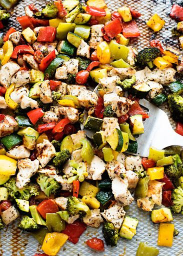Oven-roasted Chicken And Veggies With Chicken Breasts, Red Bell Pepper, Green Bell Pepper, Yellow Bell Pepper, Purple Onion, Zucchini, Broccoli Florets, Grape Tomatoes, Olive Oil, Salt, Black Pepper, Italian Seasoning