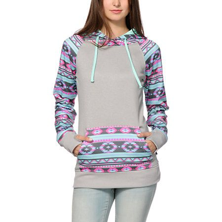 Bundle up with a vibrant look with this pullover tech fleece hoodie made with a long slim fit that is great for layering, and tribal print detailing.
