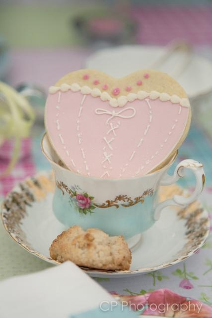 Gorgeous, original vintage teacup and saucer to hire. Heart shortbread cookie favour comes complete in cello bag and matching ribbon. From www.fuschiadesigns,co.uk.