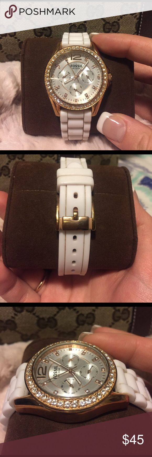 Women's fossil watch Gold watch face with pearly white inner-face and inlaid with crystal. White rubber band. Will fit most wrist sizes. Needs new watch battery to work. Watch face in perfect condition- band slightly used condition but easy to replace. Fossil Accessories Watches