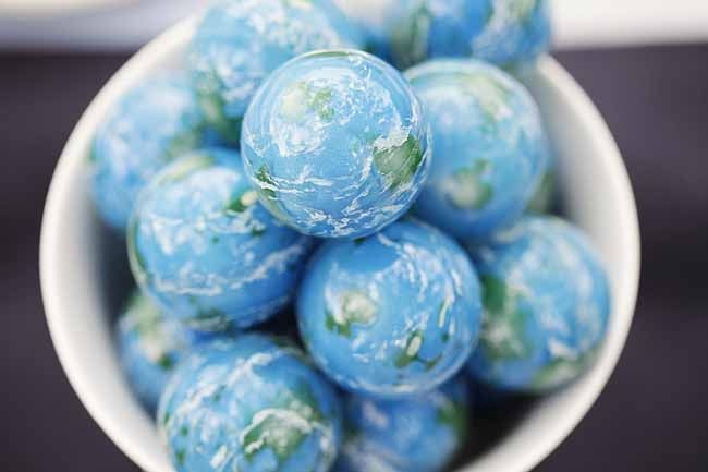 earth bouncy balls - favor idea for this absolutely gorgeous space themed astronaut boys birthday party - love all the white and hits of blue www.spaceshipsandlaserbeams.com