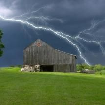 Barn on a farm during a thunderstorm