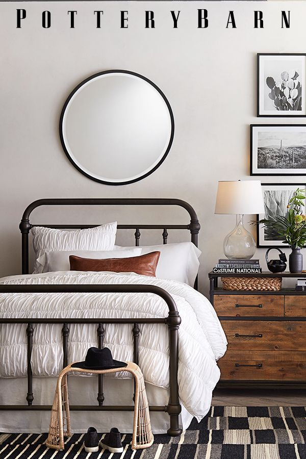 Contrast Your All White Bed With Sleek Black Accents From A Metal