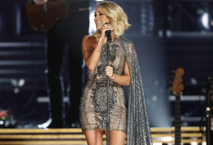 "Carrie Underwood was the top Country winner at Sunday night's American Music Awards, taking home the trophies for Favorite Female Artist — Country and Favorite Album — Country for her 2015 release, Storyteller. The superstar was not in attendance to accept the honors, but took to social media after the show to show her appreciation. ""Thank you fans,"" she gushed. ""You are the best!"""