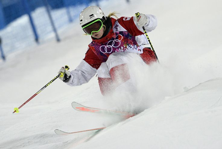 Canada's Justine Dufour-Lapointe competes during the Women's Freestyle Skiing Moguls finals at the Rosa Khutor Extreme Park during the Sochi Winter Olympics on February 8, 2014. AFP PHOTO / FRANCK FIFE (Photo credit should read FRANCK FIFE/AFP/Getty Images)