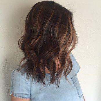 Medium length, brown hair with balayage.
