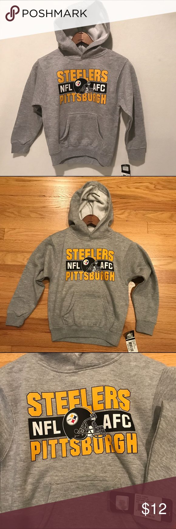 NWT REEBOK Kids Steelers Hoodie Large NFL Age 7 Reebok NFL Pittsburgh Steelers Hoodie Sweatshirt  Condition:Brand new with tags Style:Hoodie Size:child's Large. 7 years.  Shoulder width: 15 inches Length (shoulder to bottom hem): 19 inches Material: 65% cotton, 35% polyester Reebok Shirts & Tops Sweatshirts & Hoodies