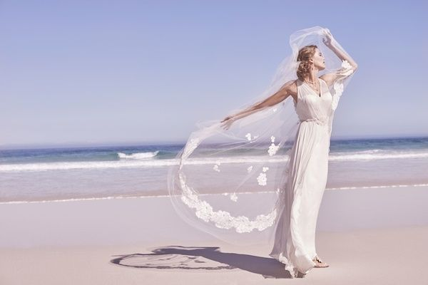 """Avril"" Wedding Dress   Article: Summer-Inspired Gowns for a Romantic Beach Wedding    Photography: Courtesy of BHLDN   Read More:  http://www.insideweddings.com/news/fashion/summer-inspired-gowns-for-a-romantic-beach-wedding/1932/"