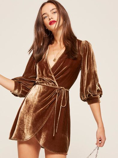 Wrap yourself up in something nice. This is a mini length wrap dress with full sleeves and elastic at the shoulders.