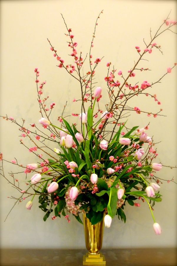 Beautiful pairing the tulips with the quince ~ French tulips and quince- little messy but I like that