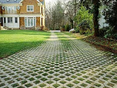An old & simple concept that is eco friendly and making a comeback ~ this permeable driveway not only blends into the natural landscape but has a surface that allows water to filter back into the ground