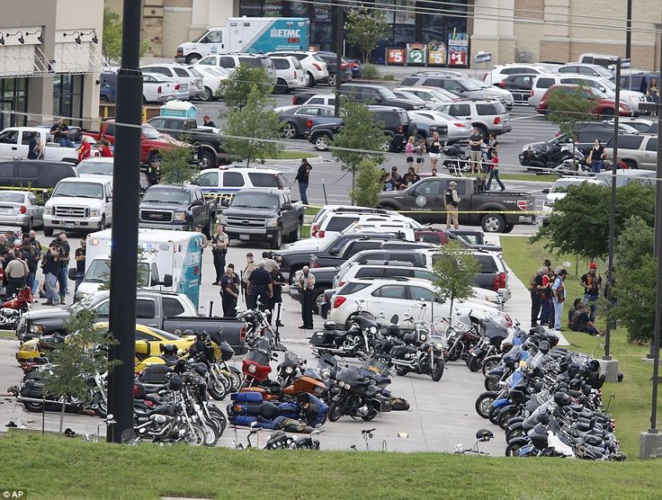 Scene: Bikers lay dead by their motorcycles in the parking lot of the Twin Peaks Bar and Grill shortly after midday on Sunday