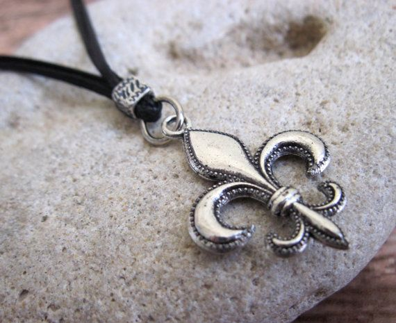 "Men's Necklace - Men's Fleur De Lis Necklace - Men's Silver Necklace - Mens Jewelry - Necklaces For Men - Jewelry For Men - Gift for Him  Looking for a gift for your man? You've found the perfect item for this!   The simple and beautiful necklace features 2 black wax wire chains with a silver plated fleur de lis pendant.  Length: 21.5"" (55 cm). $25"