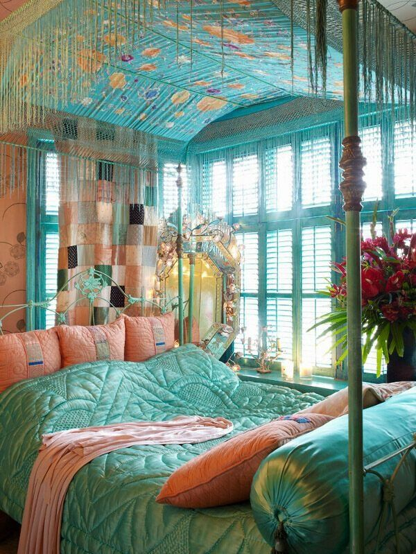 SMALL SPACE=FEELING OF CLAUSTROPHOBIA -- DEF: small space with the feeling of claustrophobia.  WHY: The colors of this room make it appear darker and a lot going on.  There are a lot of patterns and although there are windows, it still feelings tight and gloomy.