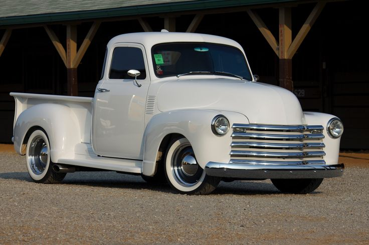 1952 5 window Chevy pickup with blue interior and blue wheels