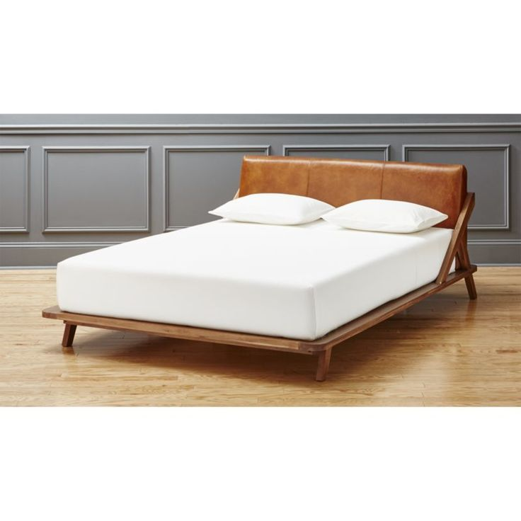 Shop drommen acacia bed with leather headboard.   Both architectural and comfy, master bed designed by Jannis Ellenberger is a dream from every angle.