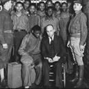 On March 26th, 1931, nine black youths riding a freight train, were arrested in Scottsboro, Alabama, after being falsely accused of raping two white women. After nearly being lynched, the Scottsboro Boys were brought toOn March 26th, 1931, nine black youths riding a freight train, were arrested in Scottsboro, Alabama, after being falsely accused of raping two white women. After nearly being L*nched, the Scottsboro Boys were brought to trial. Despite evidence that exonerated the teens…