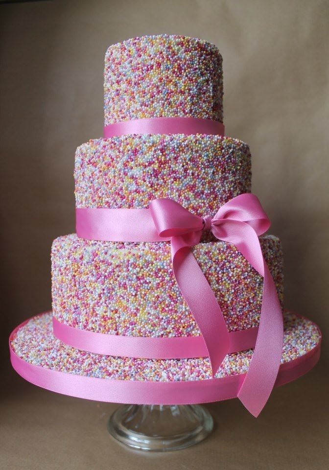 A sprinkle cake is bright and fun for a girl's birthday with a fondant bow border