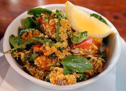 Roast pumpkin and spinach salad with quinoa and chia seeds.