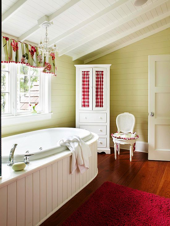 Cottage Bathroom with corner cabinet for storage.