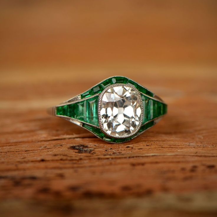 A beautiful diamond and emerald engagement ring.