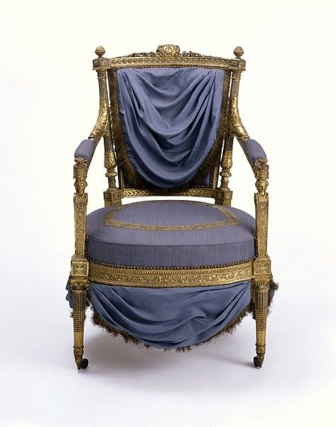 Marie Antoinette's arm chair. Her monogram MA is engraved at the top of the chair