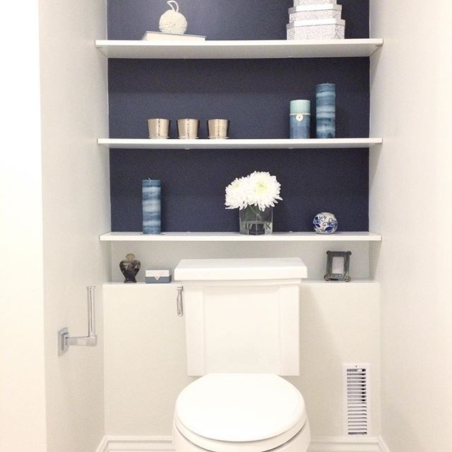 #tbt to this main bathroom renovation we did. This was a fun navy accent wall to create. Who says you can't make the toilet area pretty