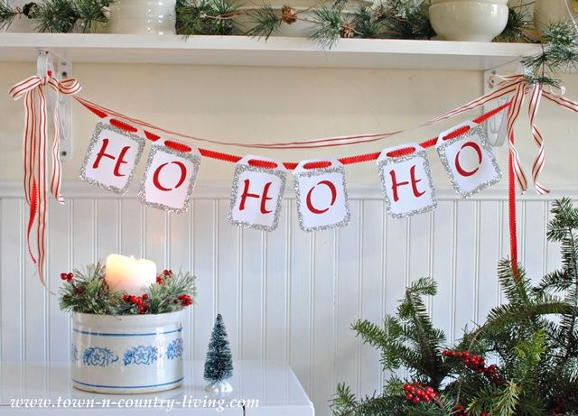 Quick and Easy Christmas Banner. White card stock is transformed into a Ho Ho Ho banner with stencils and glitter.